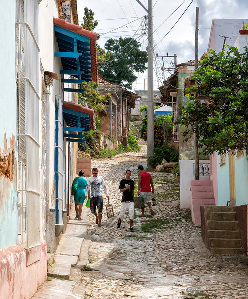 A steep side-street in Trinidad de Cuba.  This is one of the original Spanish settlements in Cuba.  Although it is a UNESCO World Heritage Site, many of the old houses are still privately owned residences. We visited one that the owners operate as a B & B under Cuba's new policies allowing an increase in private enterprise.