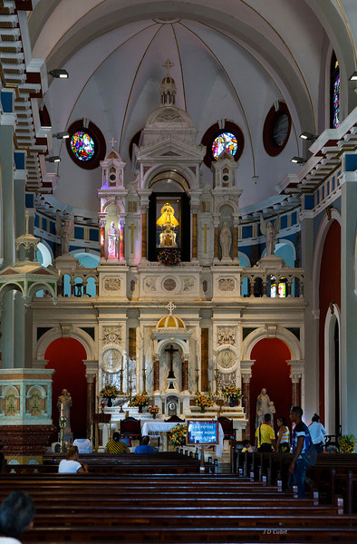 Inside the basilica.  The golden figure in the photo center is a statue of the Saint to which three sailors attribute their salvation during a storm.