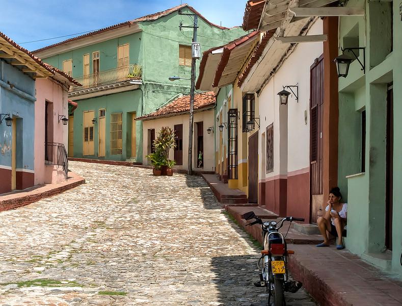 Sad faced woman on a quiet street in Sancti Spiritus, Cuba.