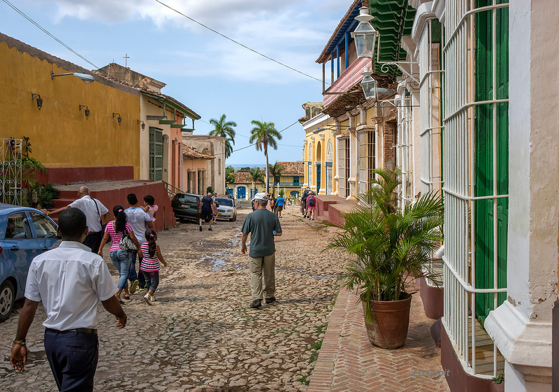 The historical heritage area of Trinidad de Cuba, with the Caribbean Sea in the distance. This is one of the few historic streets where cars are allowed.