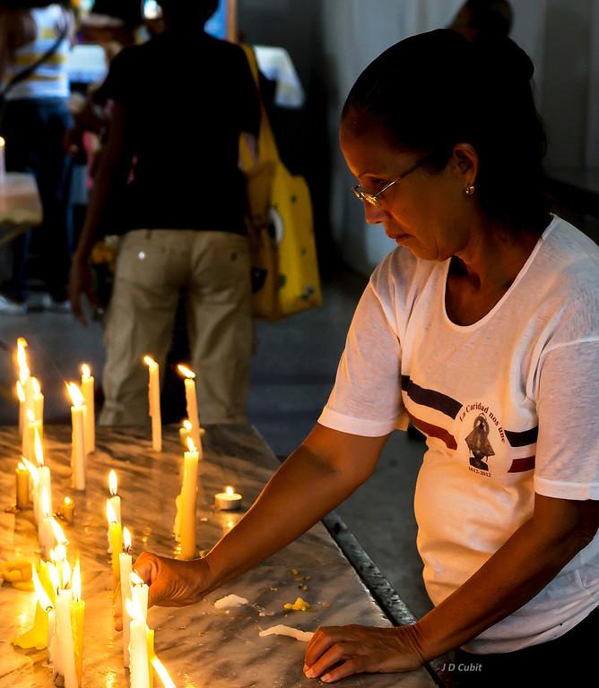 Prayers to Cuba's patron saint at the Basilica in El Cobre.