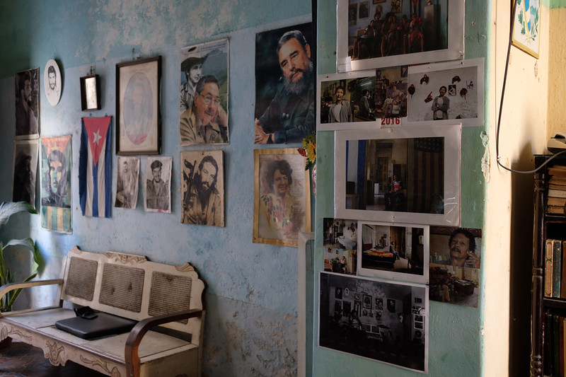 fidel, raul, che, et al.  and some photos tourists have printed and given to him from their visits to his home.