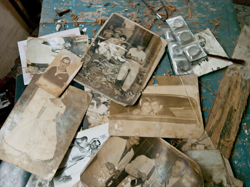 We wandered into a house whose roof had fallen in and the inhabitants had moved, leaving behind pieces of their lives.