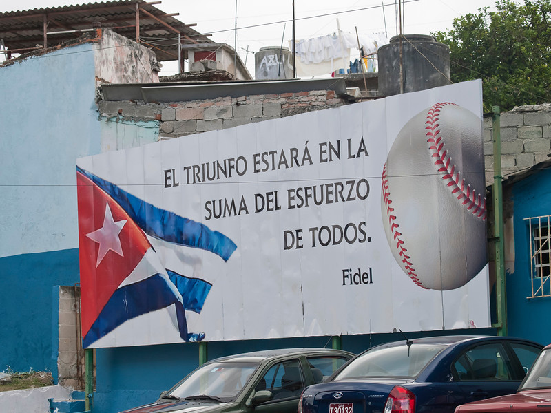 "At the ballgame, roughly translated, ""The victory will be in the amount of effort that all do.""<br /> Billboards in Cuba are only used for political purposes, never for commercial reasons."