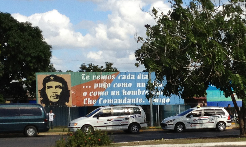 "This is also at the airport, it's from some poem about Che...""I see every day... And pure as a child or as a pure man, Comandante Che, friend"".  The dude died in 1967, yet his face is everywhere.  I think it's odd that they don't have more recent role models."
