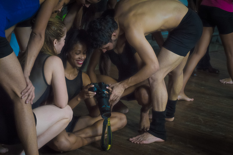 Havana. Dancers from the emerging dance troupe Danza Combinatoria enjoy viewing the images taken of them.