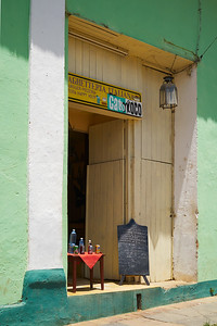 door entrance to a local bar, sunny afternoon, Trinidad, Cuba