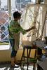 Yudit painting in her studio.