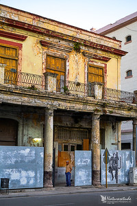 old building with a man standing in the entrance, early morning, Old Havana