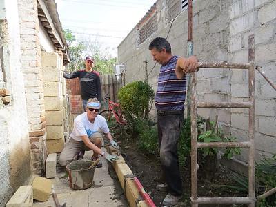 Aprendiza abanil (Spanish for apprentice mason) with Jose (foreground) and my construction partner Alejandro (behind).
