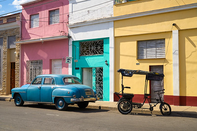 Old Plymouth and peddle taxi in Cienfuegos, Cuba