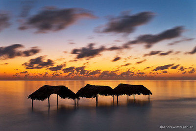 Palm Thatched Shelters at Sunrise on Cayo Guillermo, Cuba