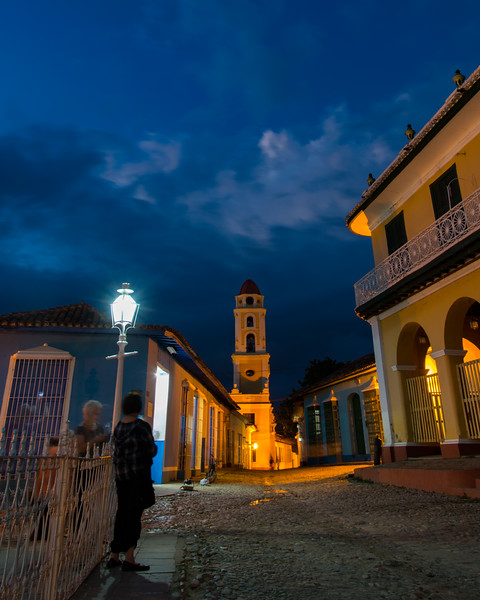 Plaza Mayor is the historic center of Trinidad. You'll see beautiful white wrought-iron fences and lamp posts, cobbled streets surrounding the square, statues of English greyhounds, and columns with large terra-cotta finials decorating the plaza. In the center of this photo is Iglesia y Convento de San Francisco. Built in 1813 by Franciscan monks, the building became a parish church in 1848, and in 1895 was converted into a garrison for Spanish troops. The church fell into disrepair, and in 1920 much of it was demolished, leaving only the bell tower and a few nearby buildings.
