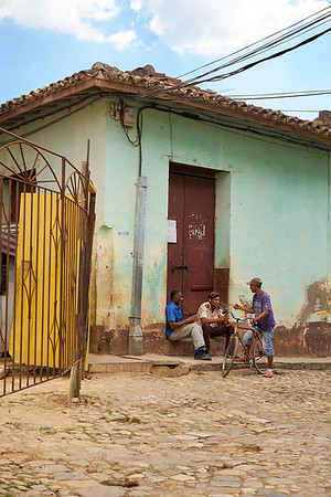 3 Cuban men talking, sunny afternoon, Trinidad, Cuba