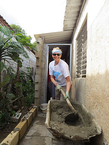 I'm helping to build a GOOD wall for Liliana and Jose's family at their home.