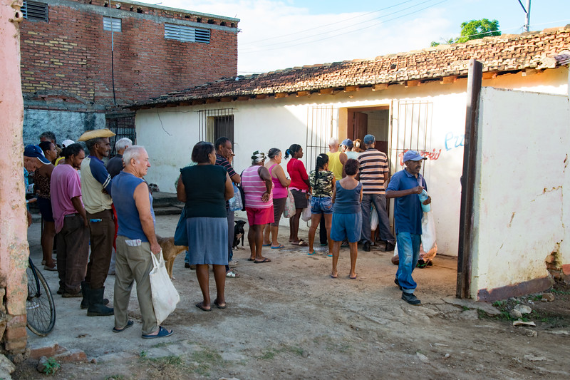 People queued to make purchases at the Market in Trinidad near Plaza Mayor.