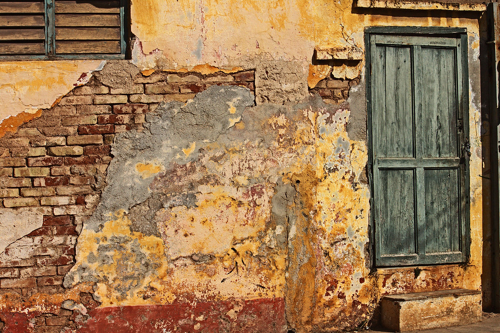 Grungy Yellow Wall and  Green Door