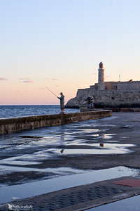 Old Castillo de San Salvador de la Punta early morning with a man fishing