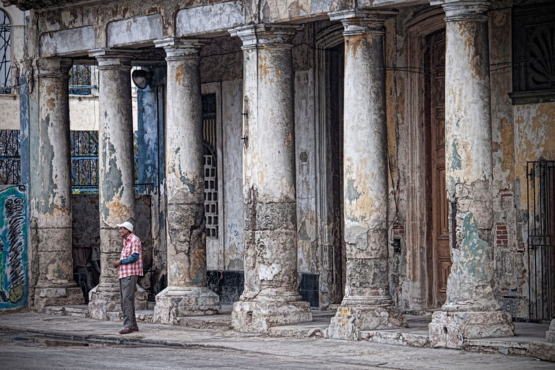 Man Near Pillars in Havana