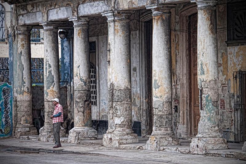 Man Near Pillars in Havana