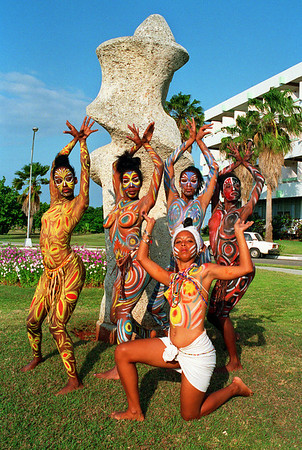 Cuban dance group, Ochumaré, poses in Varadero, Cuba.<br /> Their bodies are hand-painted before each performance.