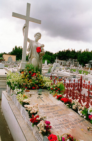 Flowers and plaques are shown along the Amelia grave site  in the Cementerio Colón, in Havana, Cuba.