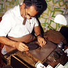 A man rolls cigars for tourists, Havana, Cuba.