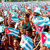 Cubans wave their flags in solidarity during a Cuban government organized rally celebrating Elian Gonzalez's return to Cuba, Manzanilla, Oriente Provence, Cuba, June 2000.