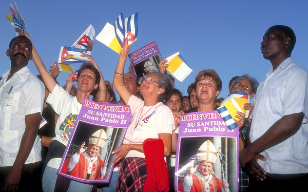 Cuban supporters of Pope John Paul II wave the Cuban flag and posters during a public Mass given by the Pope in Santiago, Cuba, January, 1998.
