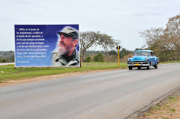 Government sponsored billboard showing Fidel Castro on highway in Havana, Cuba, 2013.