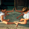 Boys play with stones in Guanabacoa, Cuba.