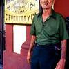 A man smokes a Cuban cigar outside the <br /> Partagas factory in Havana, Cuba.