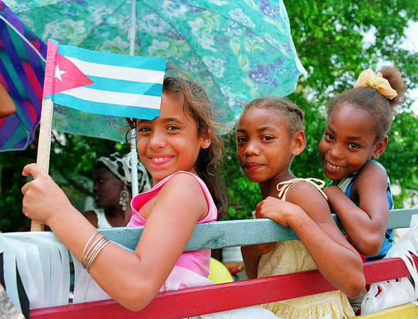 Young Cuban girls show Cuban pride with their country flag in an Anti-U.S. embargo demonstration in Havana, Cuba.
