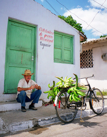 A man selling bananas in Taguaco, Cuba.