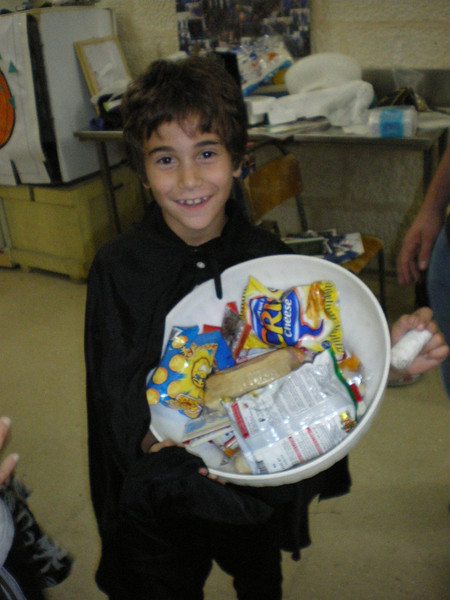 JonJon witha lll his sweets that he won!
