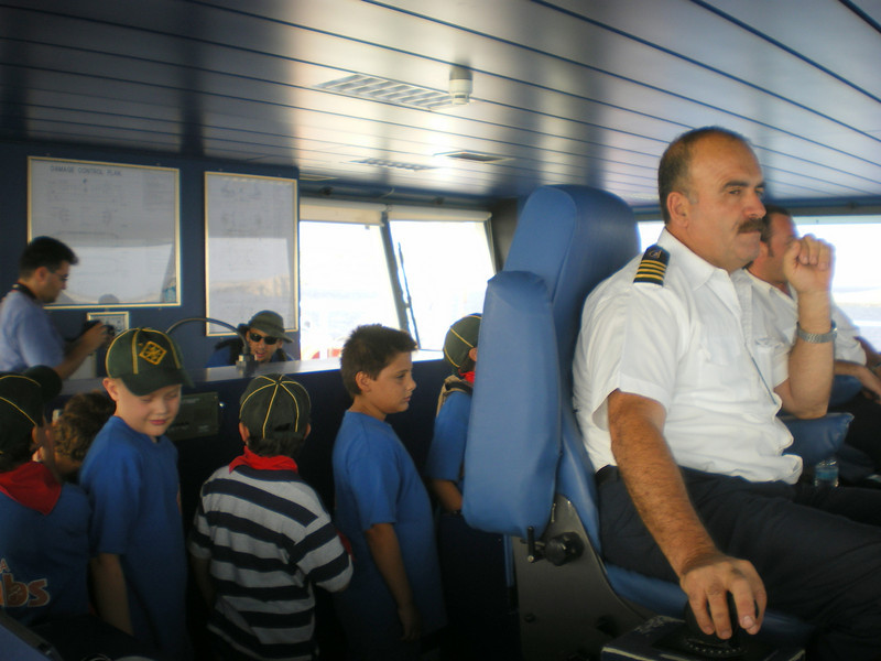cubs exploring the cabin whilst the captain controls the ferry..