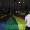 Cubs and other children playing with our parachute