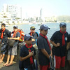 everyone listening to instructions before boarding the boats