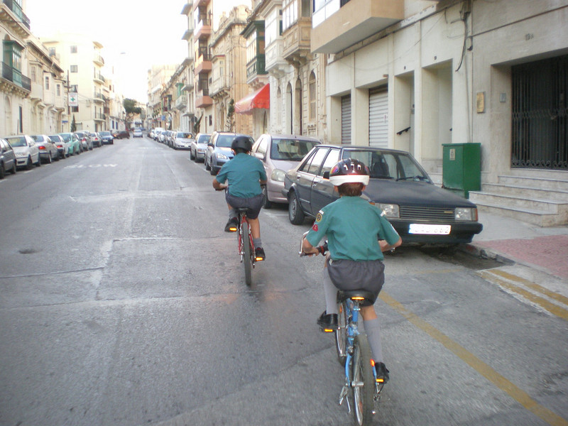 Cycling at a slow speed for annual parade