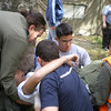The Unit lifting one of the injured..