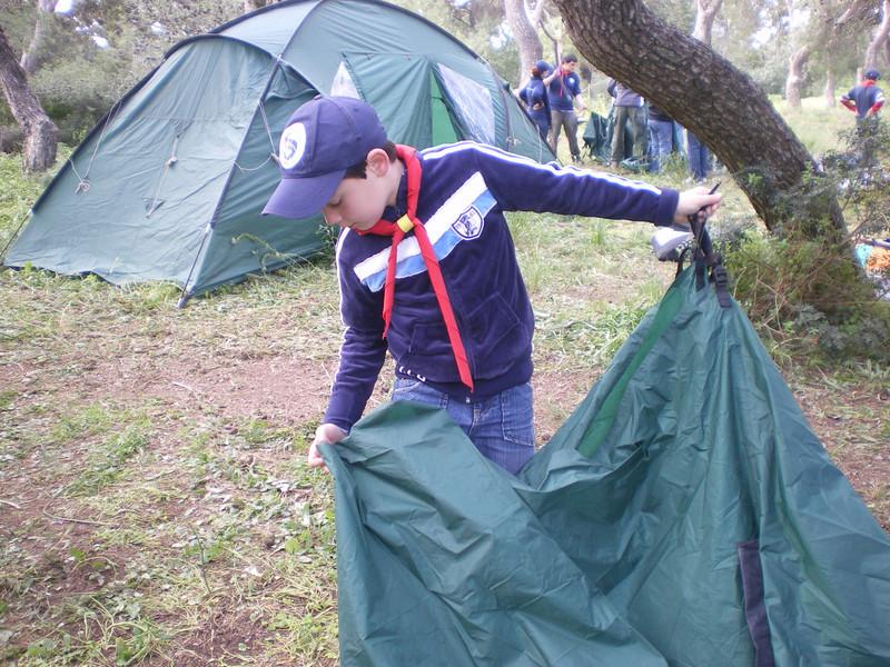 Hyams folding the tent