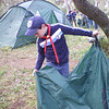 Hyams folding the tent