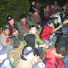 part of the pack and troop at campfire