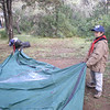 Thomas and scott folding the tent