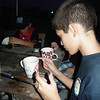 Cubs carefully painting their mugs