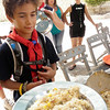 JonJon receiving his huge plate of rice salad