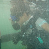 Diving instructor asking Ben if all is OK underwater..