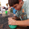 Isaac...as you can see..didnt quite get the hang of tying water balloons
