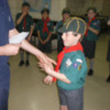 Dominik shaking hands with Akela for Tender Paw badge