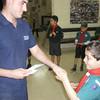 Stefan shaking hands with Akela upon receiving his Tender Paw